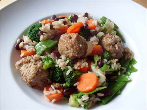 Delicious fried rice with vegetables and meatballs